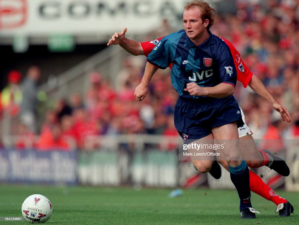 21 September 1996 - English Football Premier League - Middlesbrough v Arsenal - John Hartson of Arsenal races away from the Middlesbrough defender with the ball.