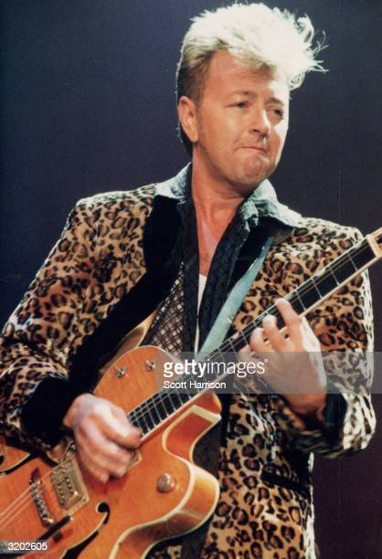 American rock guitarist Brian Setzer performs in a concert He wears a leopardskin print jacket and plays the electric guitar Setzer was formerly the...