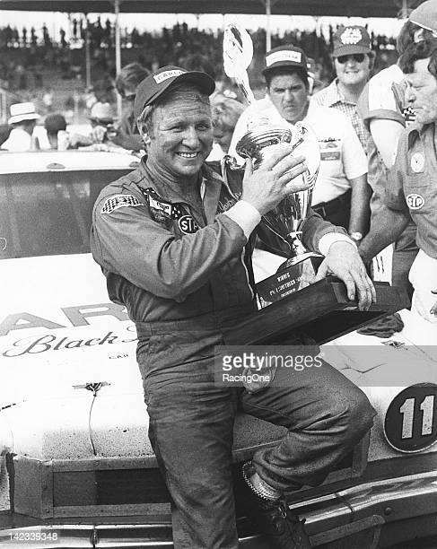 Cale Yarborough holds his trophy in victory lane at Darlington Raceway after winning the Southern 500 NASCAR Cup race