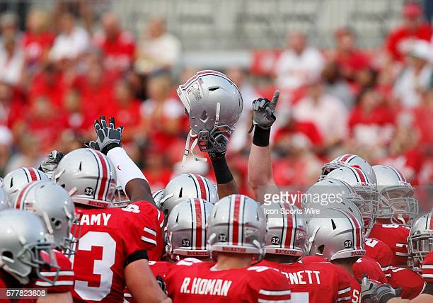 The Ohio State Buckeyes groups up and get fired up to take on the Marshall Thundering Herd Ohio State beat Marshall 457 at Ohio Stadium in Columbus...