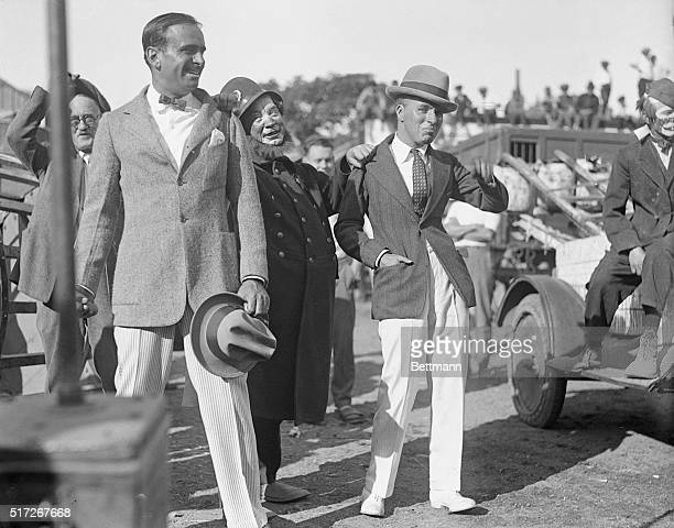 """September 20, 1922. The Greatest Show in the World. Doug Fairbanks and Chaplin """"pulled in"""" by the circus comedy cop."""