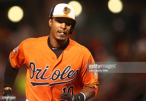 Baltimore Orioles center fielder Adam Jones comes home after hitting a two run homer during a MLB game against the Boston Red Sox at Oriole Park at...