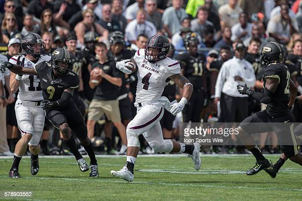 Southern Illinois Salukis tight end MyCole Pruitt runs after a catch as Purdue Boilermakers defensive back Anthony Brown Purdue Boilermakers...