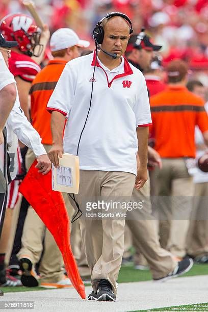 Wisconsin Badger defense coordinator Dave Aranda walks down the sideline as the Wisconsin Badgers defeated the Bowling Green Falcons at Camp Randall...