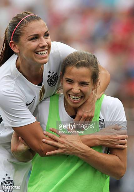 USA's Alex Morgan and Tobin Heath celebrate on the sidelines during the US Women's soccer game vs Haiti at Legion Field in Birmingham AL