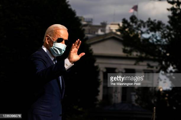 September 20, 2021: US President Joe Biden waves during his exit to board Marine One on the South Lawn at the White House on September 20, 2021.