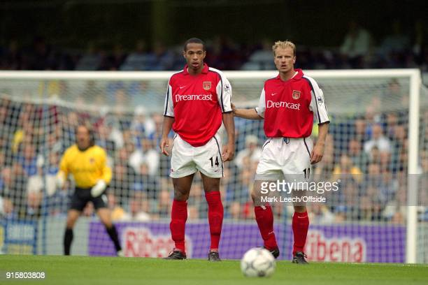08 September 2001 London FA Barclaycard Premiership Chelsea v Arsenal Dennis Bergkamp and Thierry Henry of Arsenal stand in a two man Arsenal...