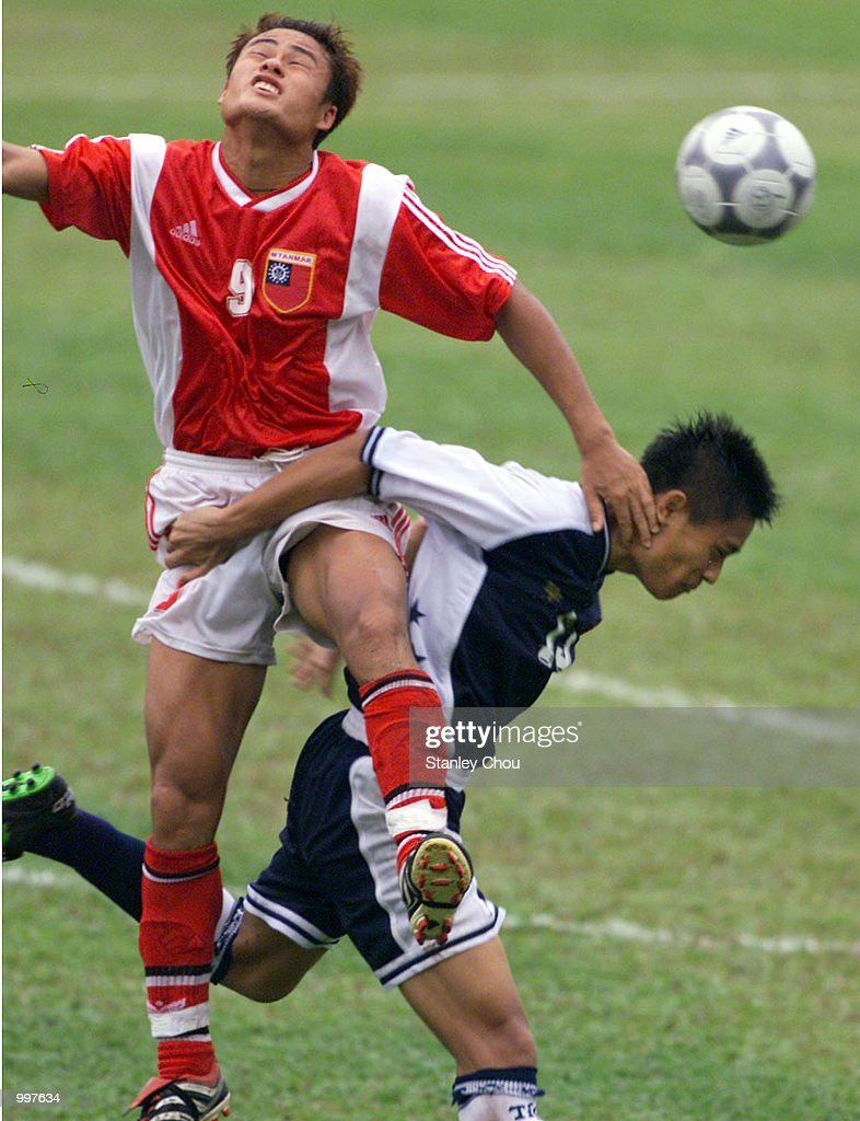 Nay Thu Hlaing of Myanmar in an aerial duo with Razaleigh Khalik of Singapore in a Group A match at the MPPJ Stadium, Petaling Jaya, Malaysia during the Under-23 Men Football Tournament of the 21st South East Asian Games. Myanmar won 2-1. DIGITAL IMAGE. Mandatory Credit: Stanley Chou/ALLSPORT