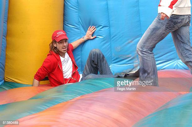 7 september 2003 ANGUS KENNETT having fun with few young models in the Jumping Castle at the Queen Victoria Market Just before the Queen Vic Style...