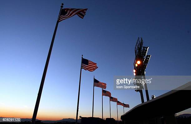 Flags and lights line the sky of dodger stadium during a major league baseball game between the Los Angeles Dodgers and the San Diego Padres at...