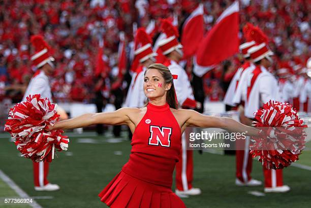 Nebraska cheerleader pumps up the crowd before the start of the Huskers' 38-7 victory over the Aggies at Memorial Stadium in Lincoln, Neb.