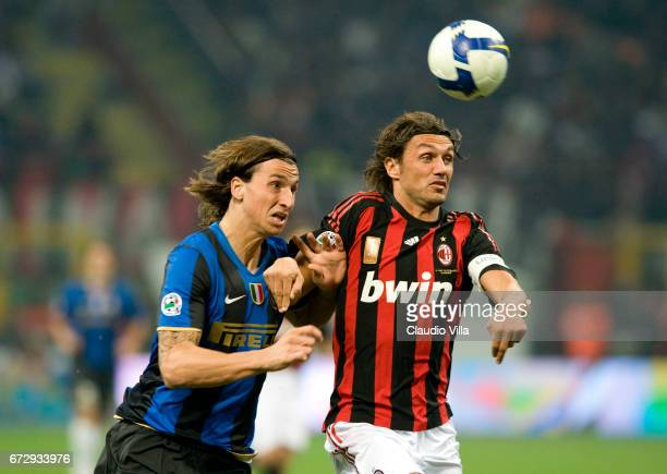 "September 2008: Zlatan Ibrahimovic of FC Internazionale and Paolo Maldini of AC Milan compete for the ball during the ""Serie A"" 2008-2009 match,..."