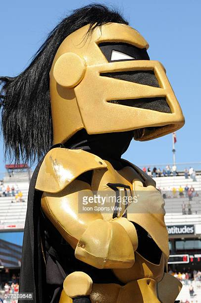 UCF Mascot takes a moment from his duties for the National Anthem before the start of the BC v UCF game at Alumni Stadium in Chestnut Hill MA