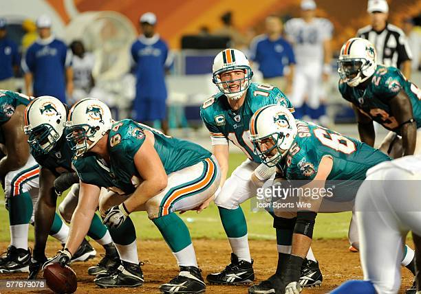 Miami Dolphins Quarterback Chad Pennington prepares to take the snap of the ball from Miami Dolphins Center Jake Grove with Miami Dolphins Guard...