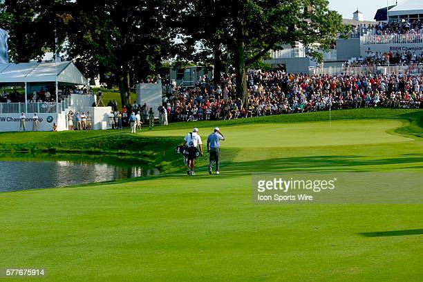 PGA Pro Tiger Woods walks up to the 18th green to a thunderous ovation from the huge crowd during the 3rd round of the BMW Golf Classic at Cog Hill...