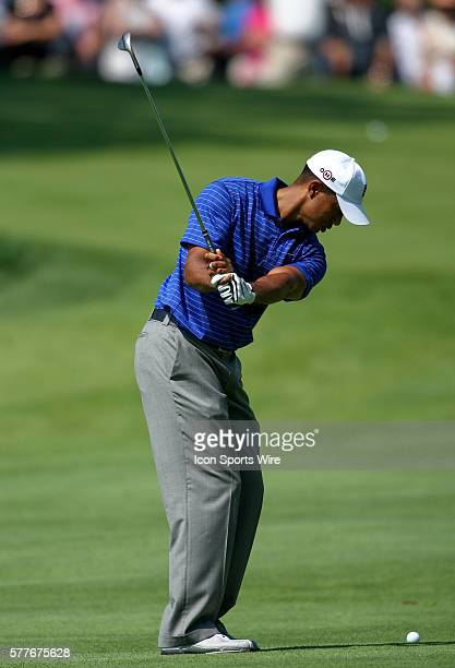 Tiger Woods gets ready to hit a in round one of the BMW Championship at Cog Hill Golf and Country Club in Lemont IL