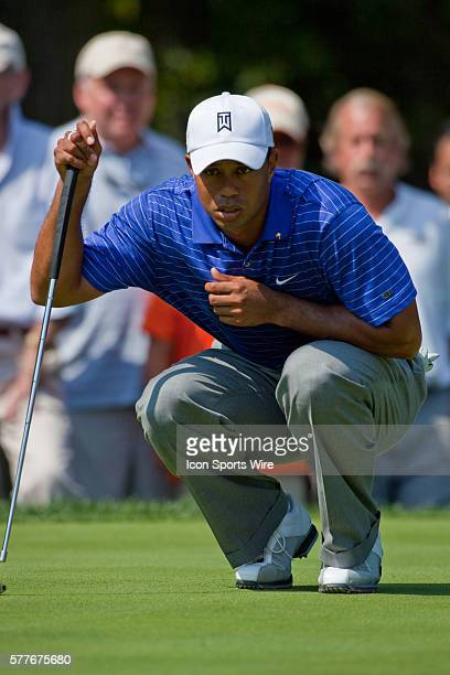 Tiger Woods lines up for a putt in round one of the BMW Championship at Cog Hill Golf and Country Club in Lemont IL