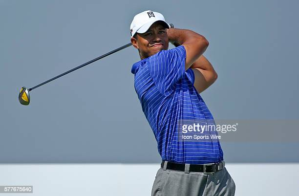Tiger Woods tees off of hole 18 in round one of the BMW Championship at Cog Hill Golf and Country Club in Lemont IL