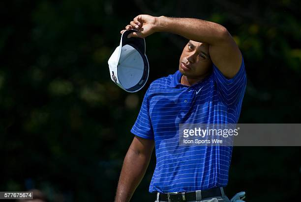 Tiger Woods wipes the sweat off of his head in round one of the BMW Championship at Cog Hill Golf and Country Club in Lemont IL
