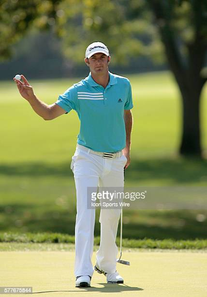 PGA Pro Dustin Johnson acknowledges the crowd after a Birdie on the Par5 11th hole during 2nd Round action at the BMW Golf Classic at Cog Hill Golf...