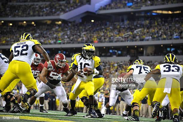 Michigan Wolverines quarterback Denard Robinson in action on the three yard line during the NCAA Football game between the University of Alabama...