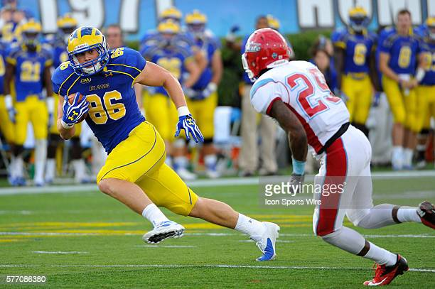Delaware Fightin Blue Hens tight end Nick Boyle runs the ball in for a touchdown during a game against instate rival Delaware State Hornets at Tubby...