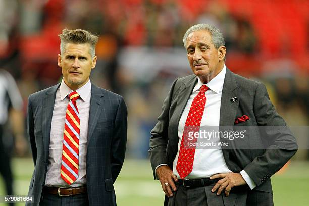 Atlanta Falcons general manager Thomas Dimitroff and owner Arthur Blank speak prior to the Atlanta Falcons 3734 victory over the New Orleans Saints...