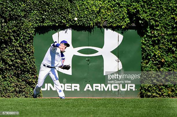 Chicago Cubs right fielder Ryan Kalish throwing to second base keeping the base runner honest while playing in a MLB game between the Chicago Cubs...