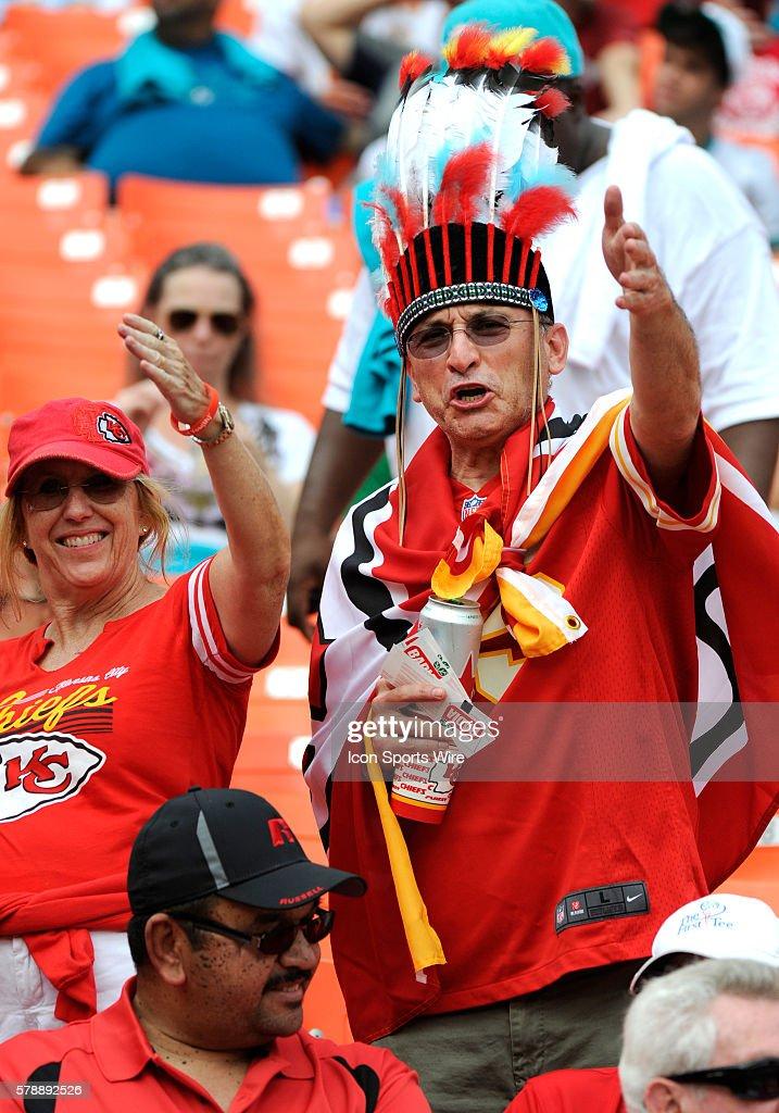 price reduced 4a4de 0c425 Kansas City Chiefs fans wearing an Indian headdress cheer in ...