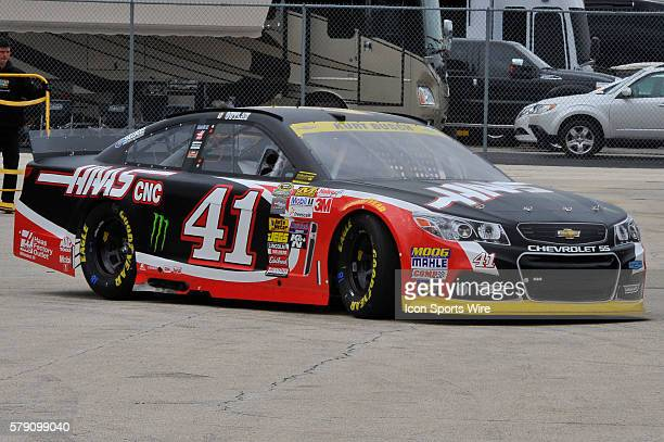 Kurt Busch heading out of the garage to a practice session for the AFibStorycom 400 at ChicagoLand Speedway Joliet Il