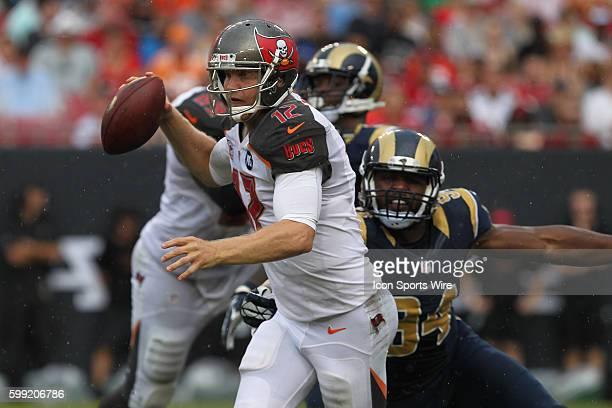 Tampa Bay Buccaneers quarterback Josh McCown scrambles to avoid St Louis Rams defensive end Robert Quinn during the NFL regular season game between...