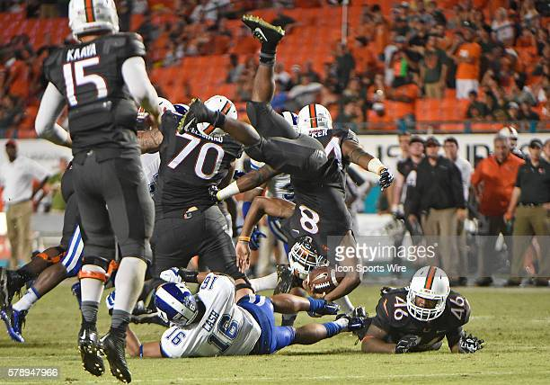 University of Miami running back Duke Johnson is tackled by Duke University safety Jeremy Cash in Miami's 2210 victory at Sun Life Stadium Miami...