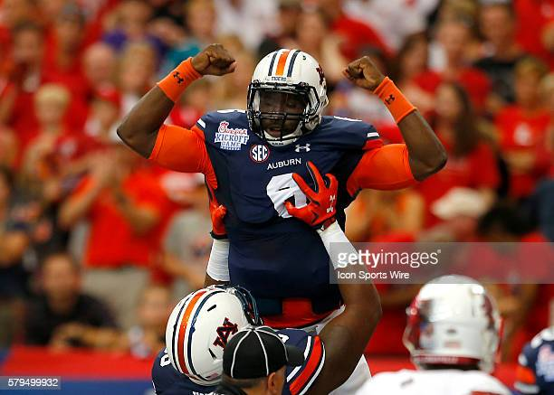 Auburn Tigers quarterback Jeremy Johnson celebrates a touchdown in first half action of the Auburn Tigers v Louisville Cardinals game in the...