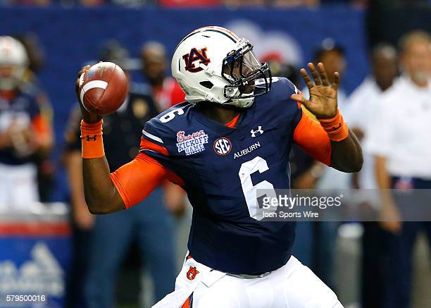 Auburn Tigers quarterback Jeremy Johnson passes in first half action of the Auburn Tigers v Louisville Cardinals game in the ChickFilA kickoff game...