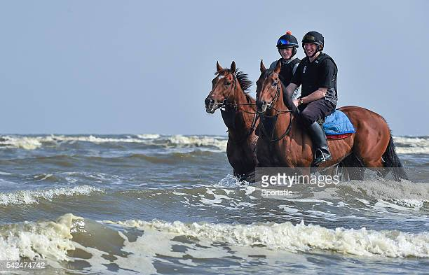 10 September 2015 Jockeys and horses ride through the surf before the races begin Laytown Races Laytown Co Meath Picture credit Cody Glenn /...