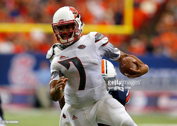 Louisville Cardinals quarterback Reggie Bonnafon is brought down from behind Auburn Tigers defensive back Johnathan Ford in first half action of the...