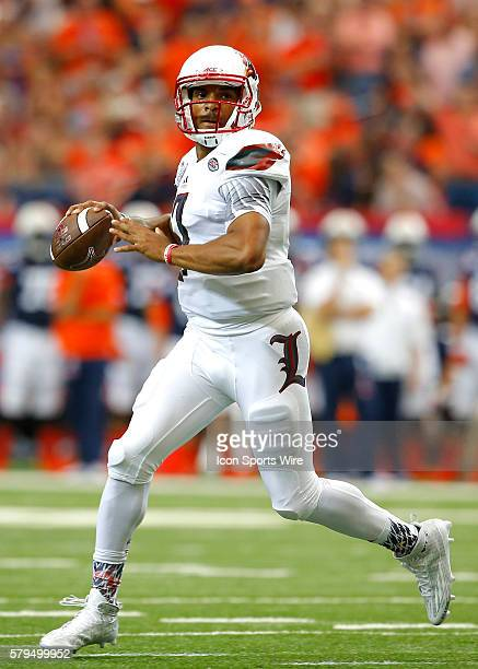 Louisville Cardinals quarterback Reggie Bonnafon rolls out to pass in first half action of the Auburn Tigers v Louisville Cardinals game in the...