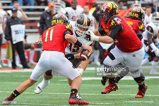 Maryland Terrapins quarterback Perry Hills is pressured out of the pocket by Bowling Green Falcons defensive lineman Zach Colvin at Byrd Stadium in...