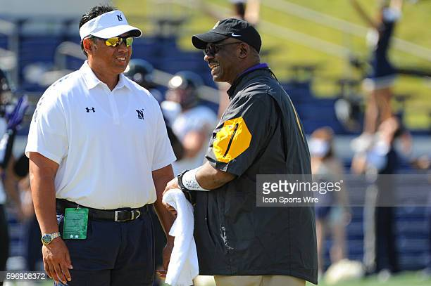 Navy Midshipmen head coach Ken Niumataolo talks with East Carolina Pirates head coach Ruffin McNeill at Marine Corps Memorial Stadium in Annapolis MD...