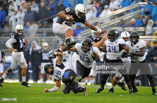 Penn State true freshman RB Saquon Barkley hurdles Buffalo's Ryan Williamson and Nick Gilbo during a long gain Barkley ran for 115 yards and a...