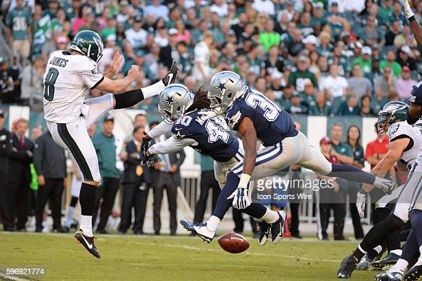 Philadelphia Eagles punter Donnie Jones gets a punt blocked by Dallas Cowboys defensive back Danny McCray and Dallas Cowboys cornerback Byron Jones...