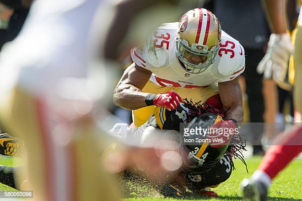 Pittsburgh Steelers Running Back DeAngelo Williams [7710] is tackled by San Francisco 49ers Safety Eric Reid [18820] in action during a game between...