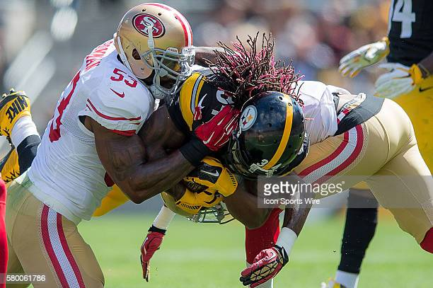 Pittsburgh Steelers Running Back DeAngelo Williams [7710] battles with San Francisco 49ers Linebacker NaVorro Bowman [9047] in action during a game...