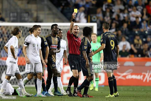 Referee Ted Unkel shows a yellow card to Philadelphia's Michael Lahoud The Philadelphia Union hosted Sporting Kansas City at PPL Park in Chester...