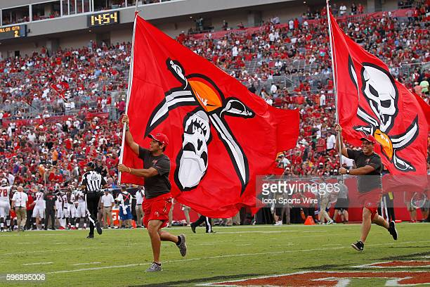 The flag runner runs with the Buccaneers logo flag mistakingly upside down during a touchdown celebration in the 2nd quarter of the NFL Week 1 game...