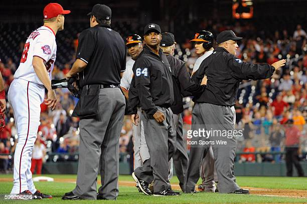 Washington Nationals relief pitcher Jonathan Papelbon is restrained by home plate umpire Mark Ripperger after hitting Baltimore Orioles third baseman...