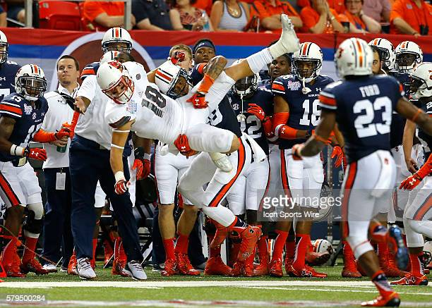 Louisville Cardinals tight end Cole Hikutini has the pass broken up by Auburn Tigers defensive back Tray Matthews in first half action of the Auburn...
