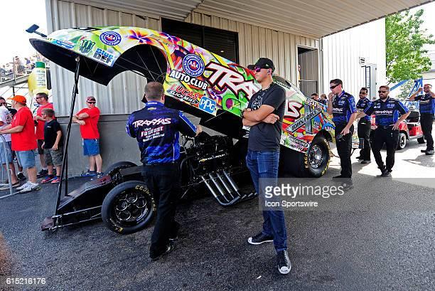 25 September 2016   24 September 2016   IndyCar driver Graham Rahal watches as Courtney Force John Force Racing Chevrolet Camaro NHRA Funny Car rolls...