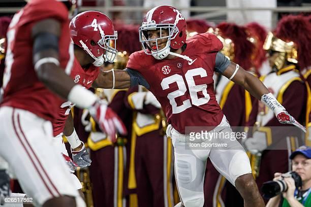 Alabama Crimson Tide cornerback Marlon Humphrey and safety Eddie Jackson celebrate Humphrey's interception return for a touchdown during the Advocare...