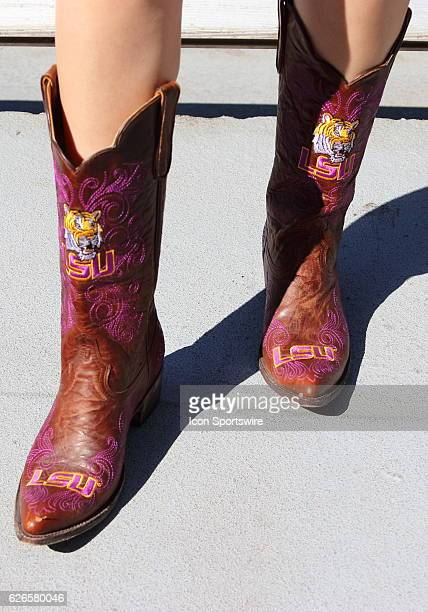 An LSU fan sports Tiger boots during pregame action in anticipation of the Lambeau Field College Classic LSU at Wisconsin at Lambeau Field in Green...